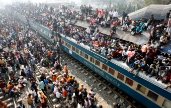 An overcrowded train leaves Dhaka's Airport rail station ahead of the Muslim festival Eid-al-Adha December 20, 2007. Bangladeshi Muslims will celebrate the festival on Friday. Muslims around the world celebrate Eid-al-Adha to mark the end of the haj by slaughtering sheep, goats, cows and camels to commemorate Prophet Abraham's willingness to sacrifice his son Ismail on God's command. REUTERS/Rafiqur Rahman (BANGLADESH) Also see GF2DXHUDQSAA